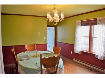 Formal dining room with hardwood floor (photo 4)