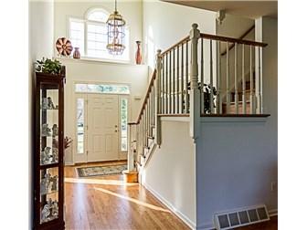 gleaming hardwood in open 2 story foyer (photo 5)