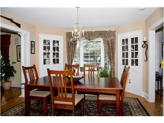 Formal dining room with built-in china cabinets! (photo 3)