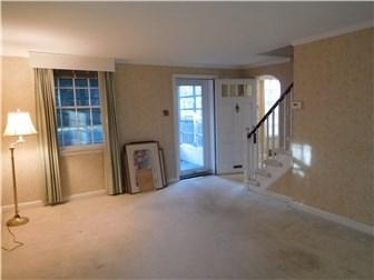 Neutral Living Rm w/hardwood floor under carpet (photo 4)