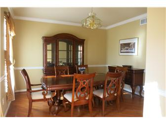 Dining rm has hardwood floors & crown molding (photo 2)