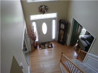 Two story hardwood entry w/ transome window (photo 5)