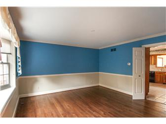 Formal Dining Room w/ Crown Molding & Chair Rail (photo 5)