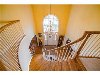 Grand Two Story Entry W/ Spiral Staircase (photo 2)