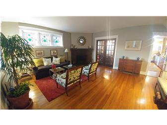 Living room w/corner fireplace & french doors (photo 2)