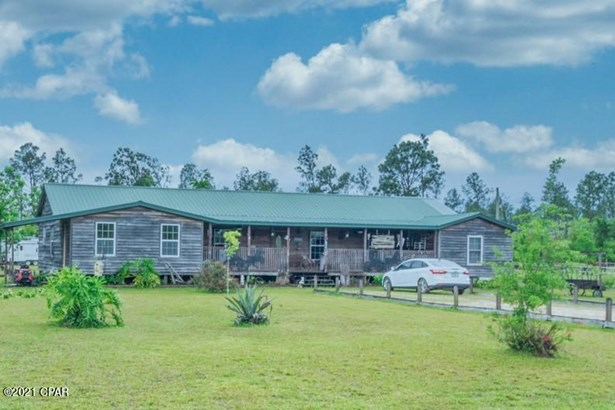 Detached Single Family, Log Cabin - Youngstown, FL