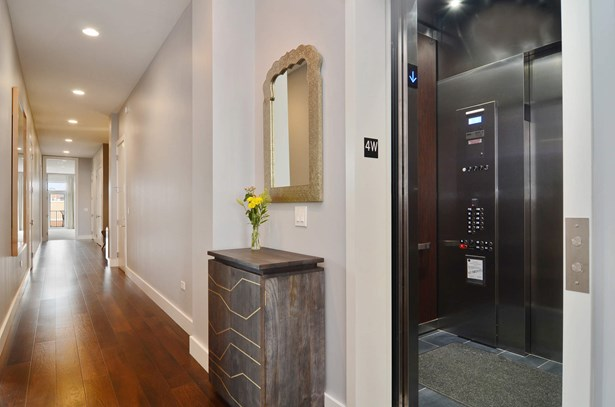 Elevator opens directly into the unit (photo 2)