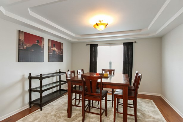 Dining Room with Tray Ceilings (photo 5)