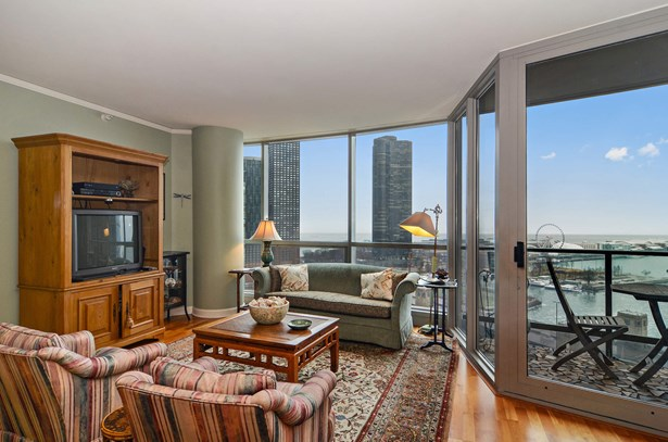 Living Room Overlooking Navy Pier & Lake (photo 3)