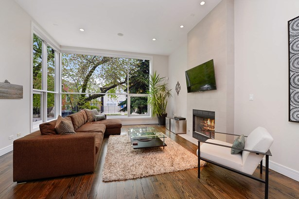 Living Room Overlooking Green Trees with Fireplace (photo 2)