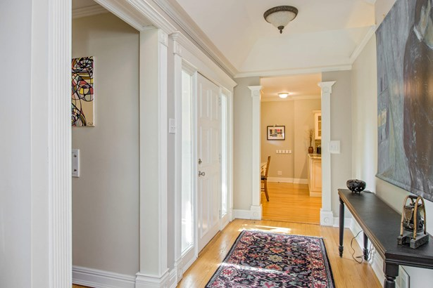 Sunny foyer welcomes you with higher ceilings and (photo 3)
