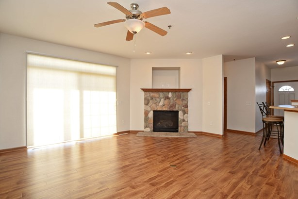 Living room with fireplace & slider to patio (photo 4)