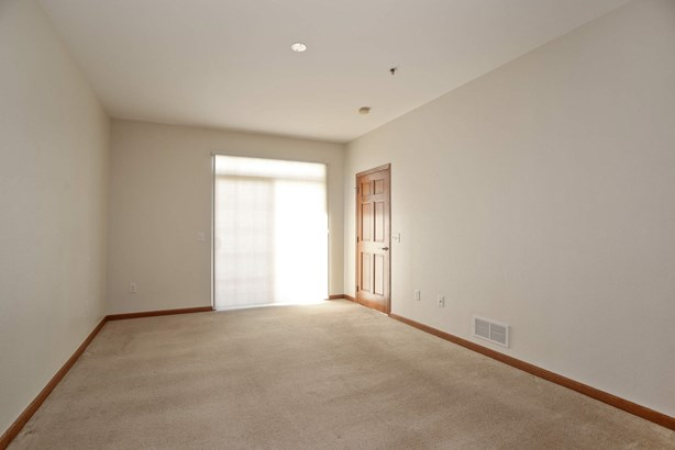 Master bedroom with slider to patio (photo 5)