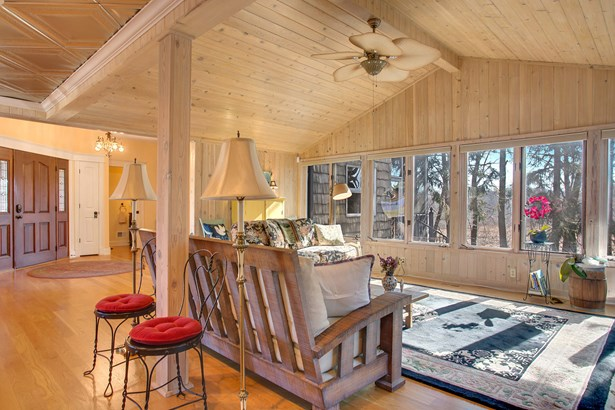Living room with knotty pine ceiling & river views (photo 3)