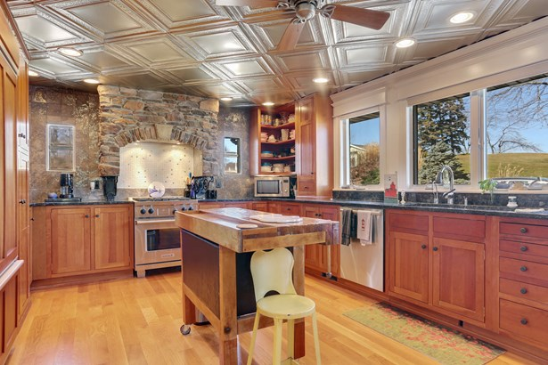 Kitchen with granite counters and Wolf gas range (photo 5)