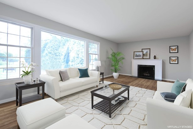 Formal living room with gas fireplace (photo 2)