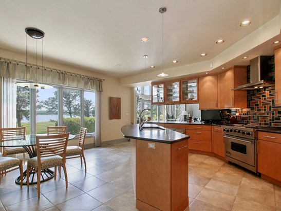 Water is the backdrop for the kitchen. (photo 5)