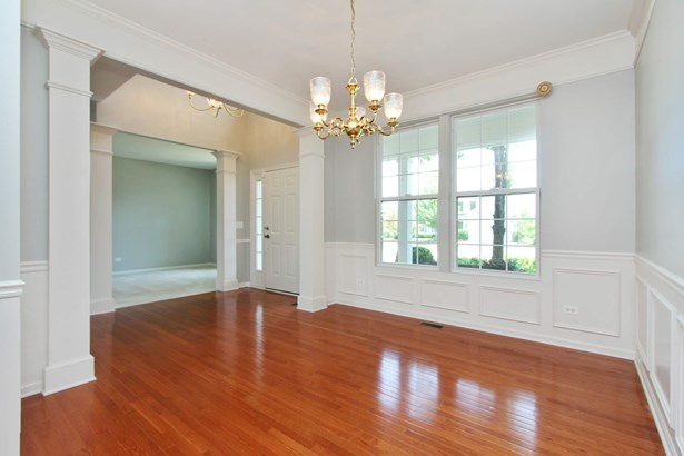 Crown moldings breeze into 2-story foyer (photo 3)