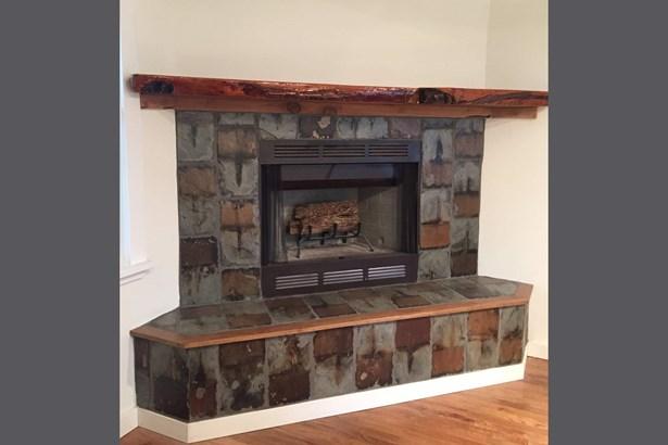 Living room wood burning fireplace (photo 4)