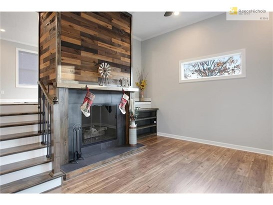 WOW - Breathtaking from the moment you step inside. The spacious living area just inside the front door features a beautiful, custom fireplace with barn-wood surround. (photo 4)