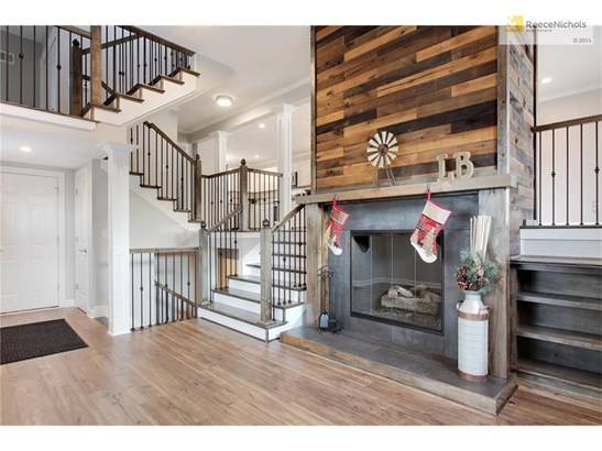 The gorgeous, custom staircases lead to the other four levels of this home. Modern, functional, and unique. (photo 5)