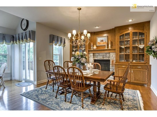 Spacious eat in kitchen with fireplace and beautiful built-ins. (photo 3)