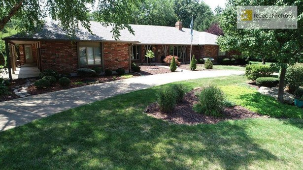 1.44 acres, circle drive, 3-car, side entry, oversized garage on a beautiful and flat lot. (photo 2)