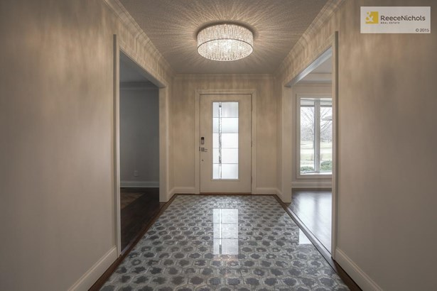 Entry hall tile floor custom designed by local artist. (photo 4)