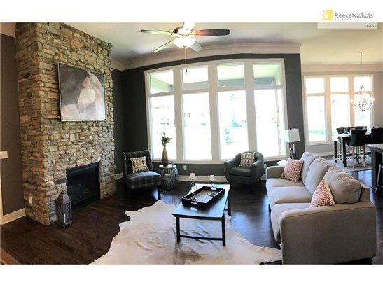 Rustic modern. Rugged stone. Polished floors. Gleaming modern fixtures. Gorgeous. (photo 4)