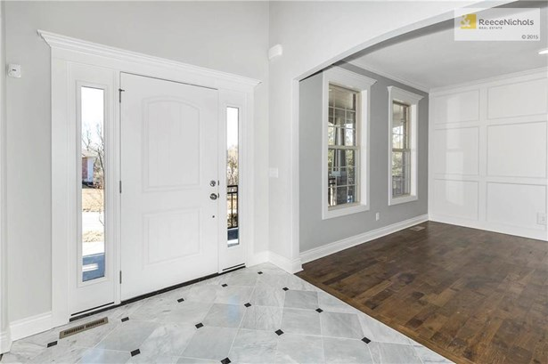 2-Story Ceilings, Marble Entry, Arched Doorways, Open To Library and Dining Room (photo 4)