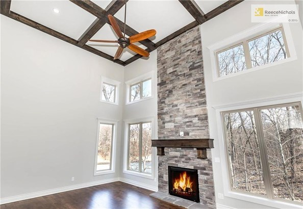 2-Story Coffered Ceilings, Floor to Ceiling Stone Fireplace, Open to Kitchen, Views of Woods & Pond (photo 5)