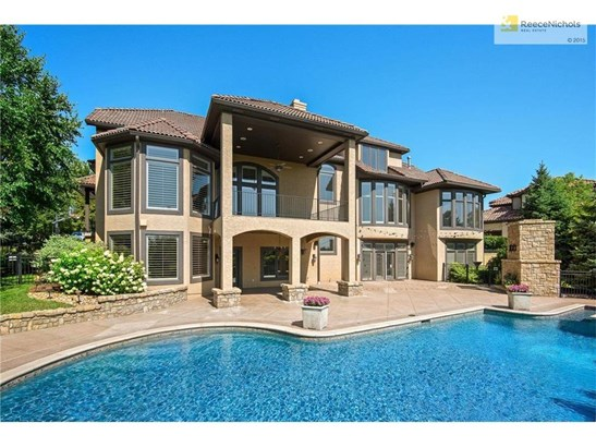 Double Entry, Tile Roof & Lush Landscaping (photo 4)