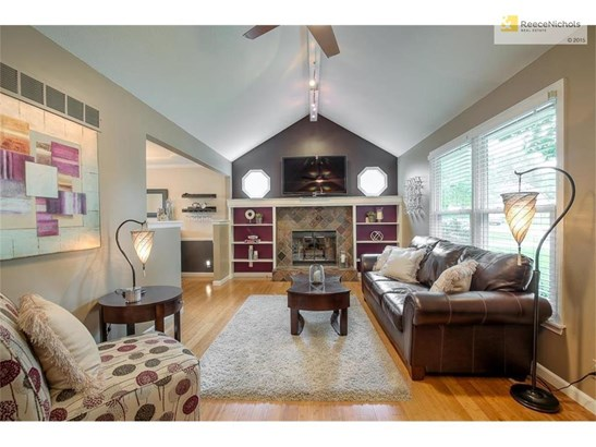 Living room w/fireplace & vaulted ceiling (photo 2)