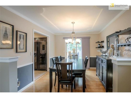 Dining room leads into kitchen & access to deck (photo 5)