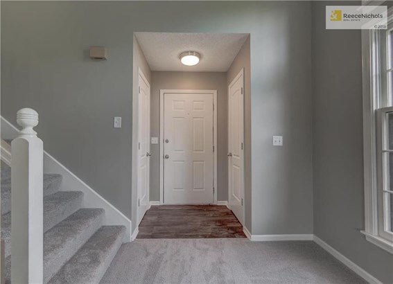 Updated floors as you enter the duplex. (photo 4)