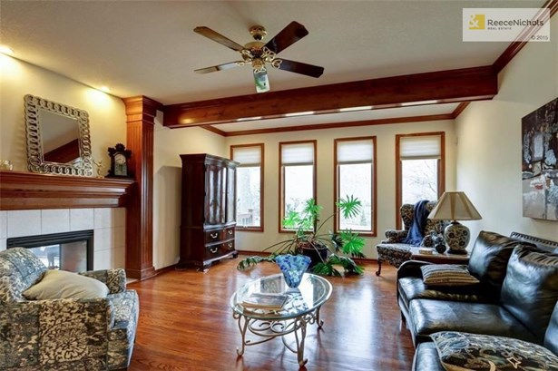 Large and inviting living room filled with bright, natural light (photo 2)