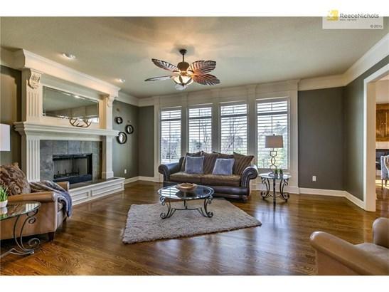 Spacious Great Room with Wall of Windows Overlooking HUGE Backyard! (photo 3)