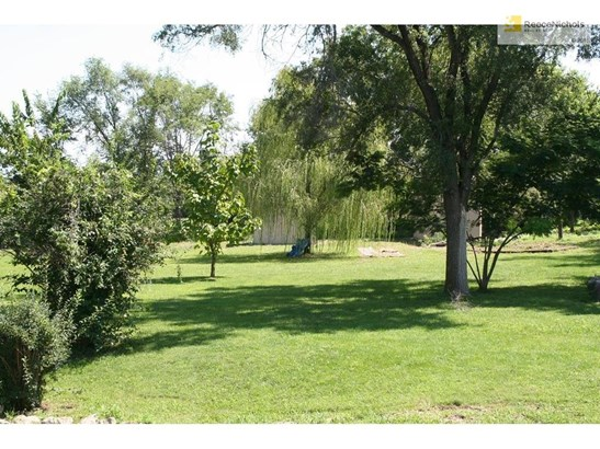 Property has an out building and a trailer that stay with the property.  Acreage is treed and has lots of wonderful spots for family picnics or outdoor activities. (photo 3)