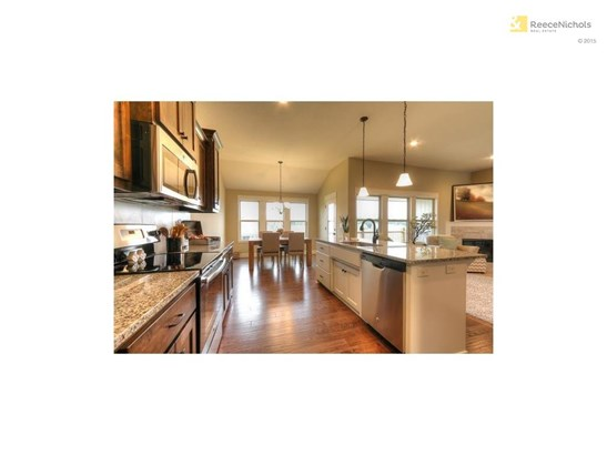Stainless steel appliances, large island, beautiful hardwood floors in kitchen and dining areal (photo 4)