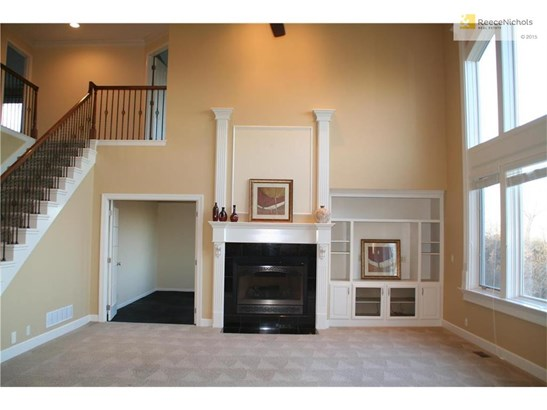 Great room features built-ins, fireplace and 18' ceilings. Picture windows overlook greenspace. (photo 2)