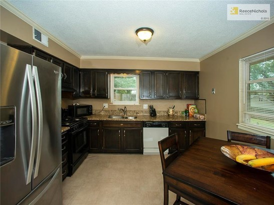 Kitchen with granite countertops and new flooring.  Gas stove (photo 5)