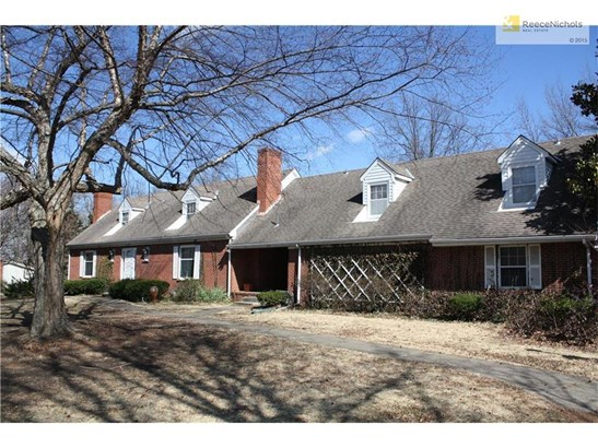 Wonderful curb appeal with brick on three sides and siding on the back. Mature trees and large driveway! (photo 1)