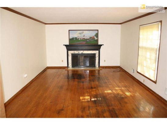 Large living room off the entry with beautiful marble fireplace and hardwood flooring. (photo 2)