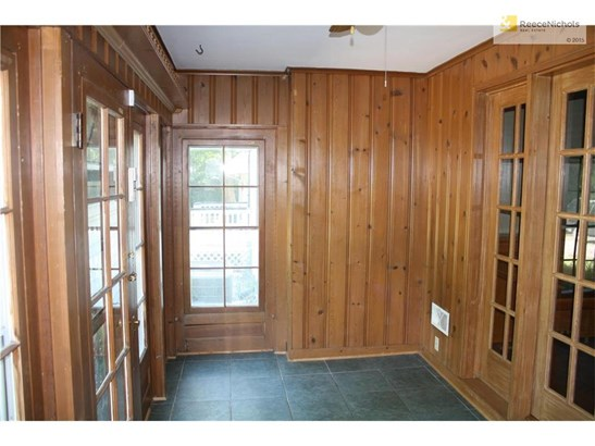 All season sun room with beautiful paneling and tile flooring. (photo 4)