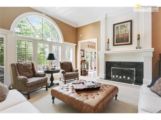 Formal Living Room looking out to paver patio & lush landscaping (photo 5)