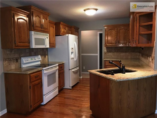 Granite counter tops, tiled back splash, custom cabinets, pull out shelves in bottom cabinets and pantry. All appliance stay including the refrigerator! (photo 2)