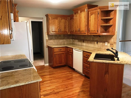 Updated faucet and under-mount granite composite sink. Hardwood floors in kitchen and eating area.  Counter top overhang for breakfast bar. (photo 3)