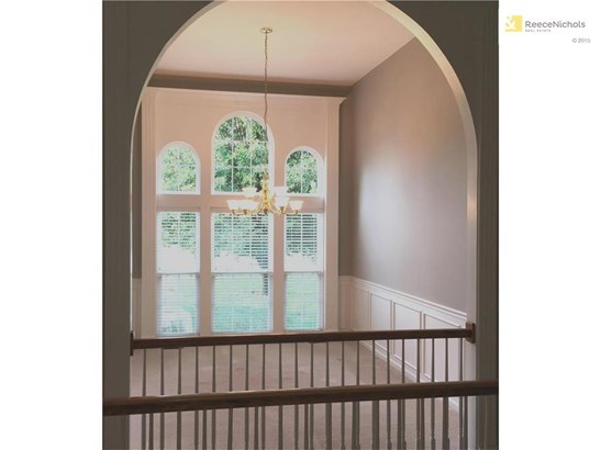 Formal dining room with wainscoting and arched transom windows. (photo 5)