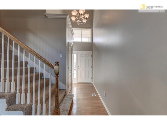Entryway with Coat Closet and Boot Bench (photo 2)