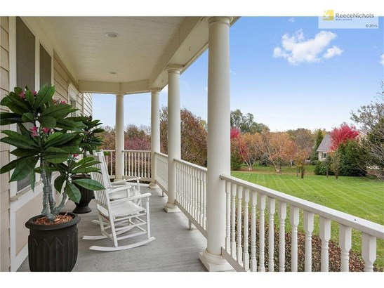 Relax on your wrap around porch & enjoy the view of the 2 acre lot (photo 2)